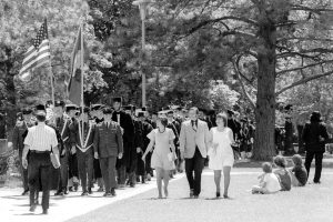 Graduating students walk to their Commencement ceremony in 1974. (Mansfield Library, University of Montana)