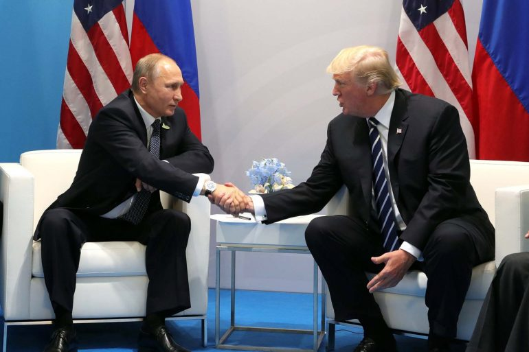 Russian President Vladimir Putin and U.S. President Donald Trump shake hands during their bilateral meeting on the sidelines at the G20 Summit in July 2017 in Hamburg, Germany. (Kremlin Pool)
