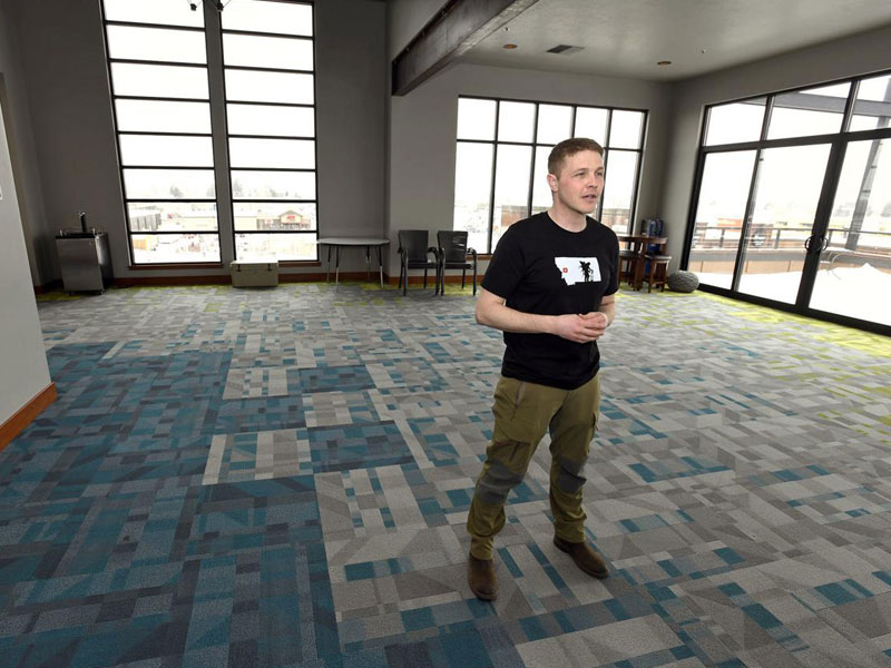Eric Siegfried, founder of onX, stands on the top floor of the mapping technology company's new building in Missoula. (Tom Bauer, Missoulian)