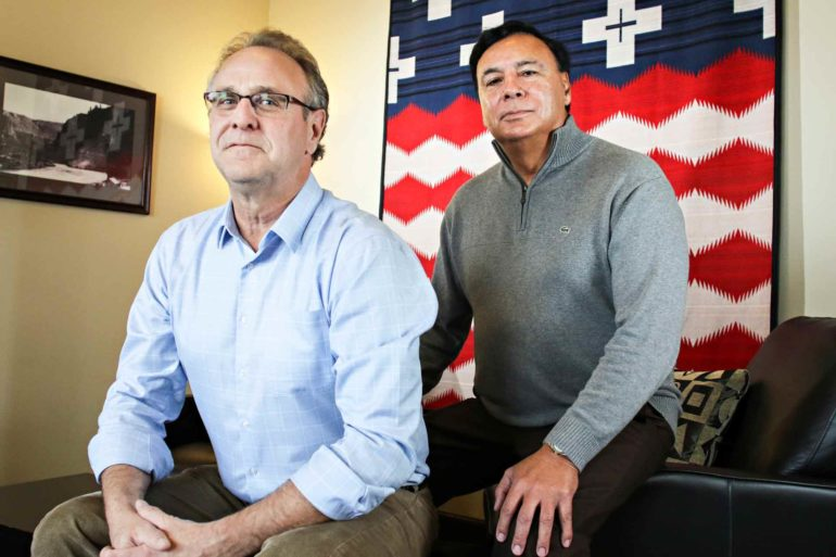 Dermot O'Halloran, left, Senior VP of Corporate Development, and Thomas Acevedo, CEO of S & K Technologies, Inc., pose at the company's headquarters in Polson, Montana. (AP Photo/Flathead Beacon, Greg Lindstrom)