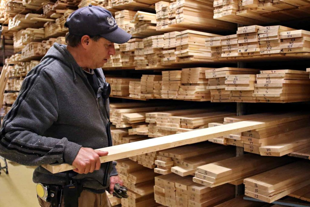 Roy Thompson shows vertical grain boards at RBM Lumber in Columbia Falls, Montana. (AP Photo/Flathead Beacon, Greg Lindstrom)
