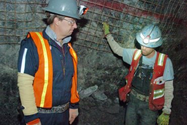 Former Stillwater Mining Company CEO Mick McMullen, left, talks about the company's mine near Nye, Montana with geologist Robbie McMahon during a visit to the underground operation in 2015. (AP Photo, Matt Brown)
