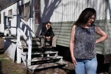 Lena Faulconbridge stands outside her home in Missoula, Montana in 2018. She faced eviction from her trailer court because it was being developed into apartments. (AP Photo/Missoulian, Kurt Wilson)
