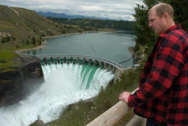 Terry McAllister looks over the Seli'š Ksanka Qlispe' Dam on the Flathead River near Polson, Montana. (AP Photo/Daily Inter Lake, Chris Jordan)