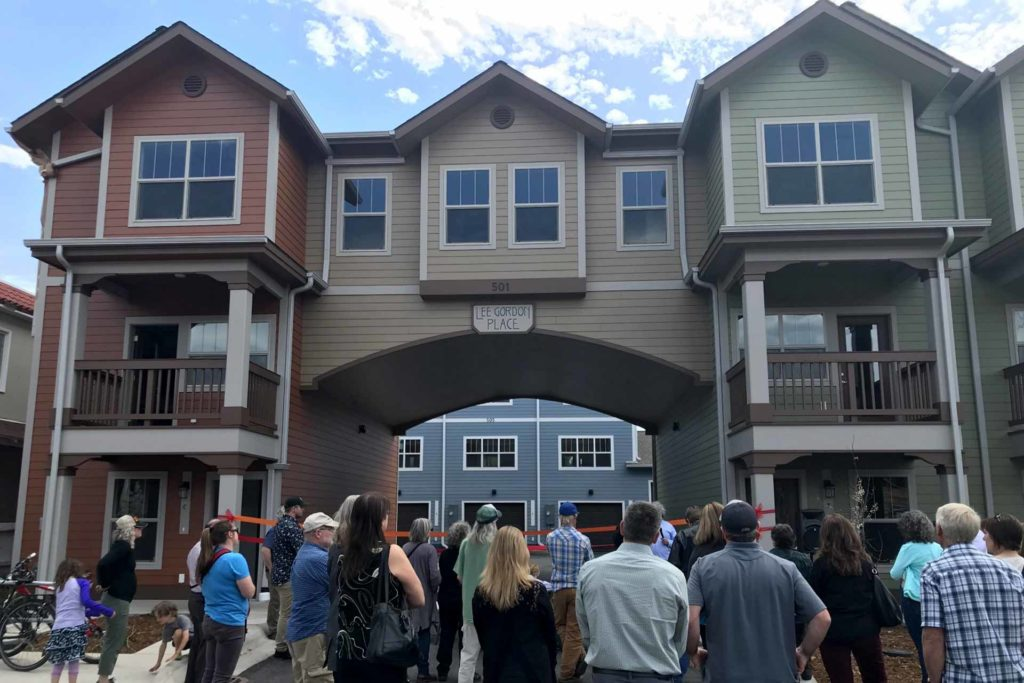 The North Missoula Community Development Corporation holds a ribbon cutting for Lee Gordon Place, seven affordable residential townhouses in downtown Missoula. (Hermina Harold)