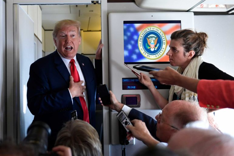 President Donald Trump talks to reporters while in flight from Billings, Montana, to Fargo, N.D. (AP Photo, Susan Walsh)