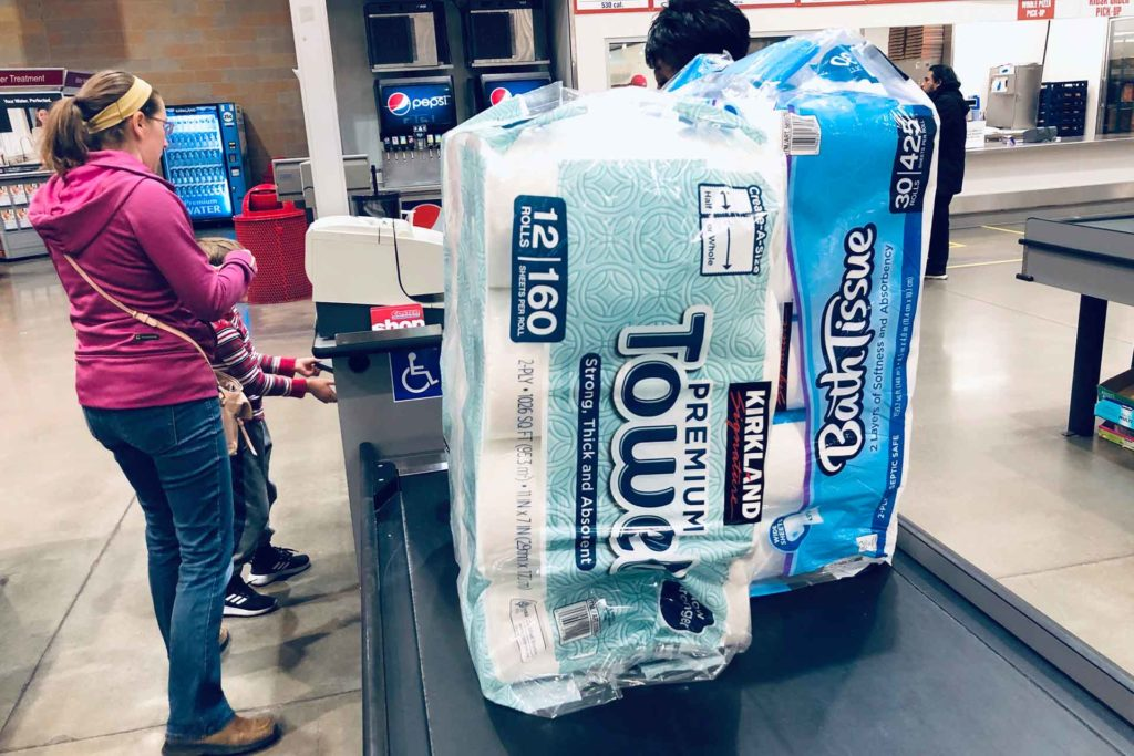 A shopper pays for packages of toilet paper and hand towels at a Costco warehouse as fear of the coronavirus spreading continues in Lone Tree, Colo. (AP Photo, David Zalubowski)