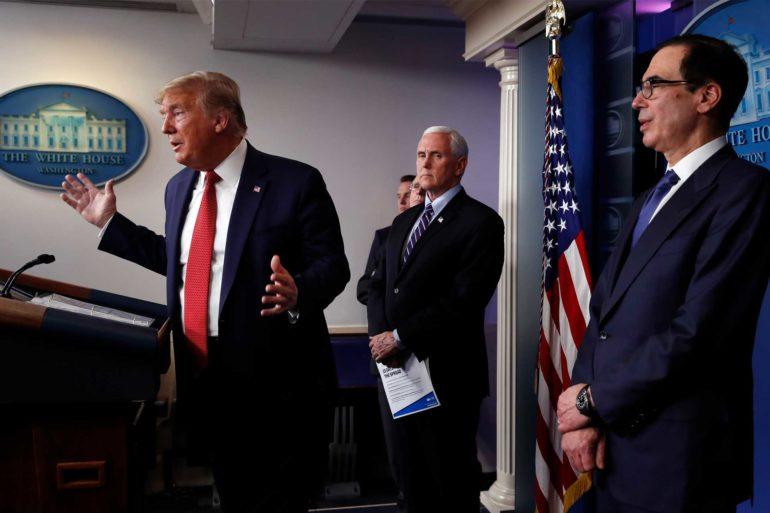 President Donald Trump speaks about the coronavirus as Vice President Mike Pence and Treasury Secretary Steven Mnuchin listen. (AP Photo, Alex Brandon)