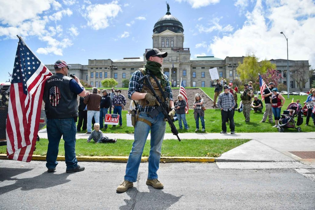 Protesters gather outside the Montana State Capitol in Helena, Montana, criticizing Gov. Steve Bullock's response to the COVID-19 pandemic. (AP Photo, Thom Bridge)