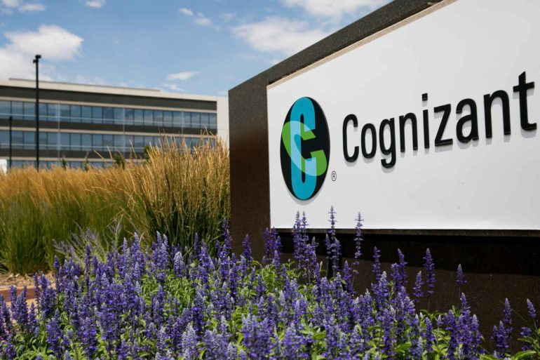 A logo sign stands outside Cognizant in Englewood, Colorado. Cognizant ATG plans to build a new tech campus in Missoula later this year. (AP Photo, Kristoffer Tripplaar)
