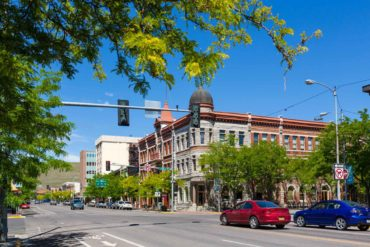 Traffic crosses Main Street in historic downtown Missoula. (Ian Dagnall)