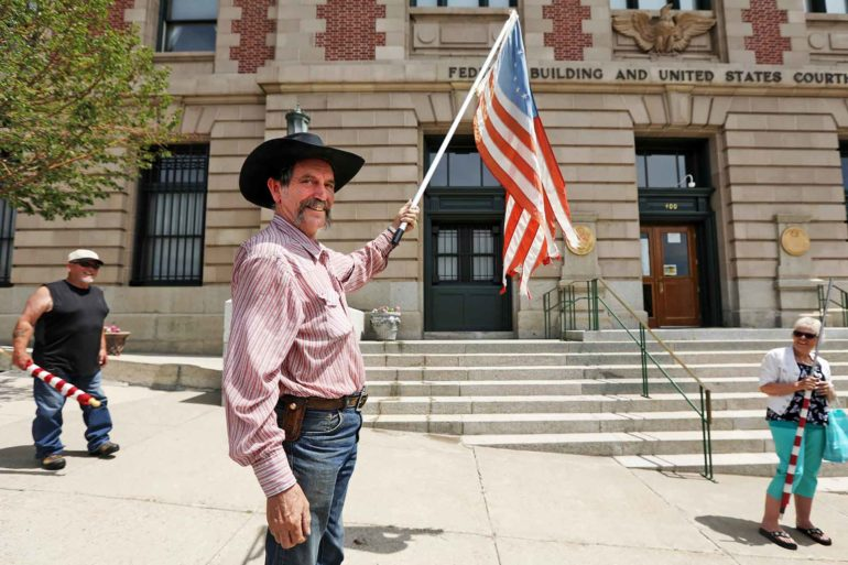 Bruce Leibold protests Montana's mask mandate in front of the Mike Mansfield Federal Building and U.S. Courthouse in Butte. (AP Photo, Meagan Thompson)