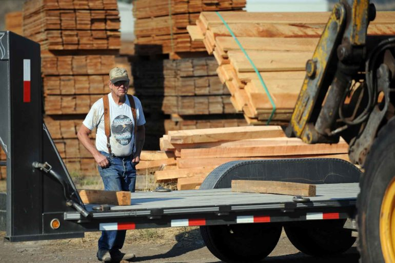 Bill Calovis watches as lumber is loaded onto his truck at the B&J Sawmill in Reed Point. (AP Photo, James Woodcock)