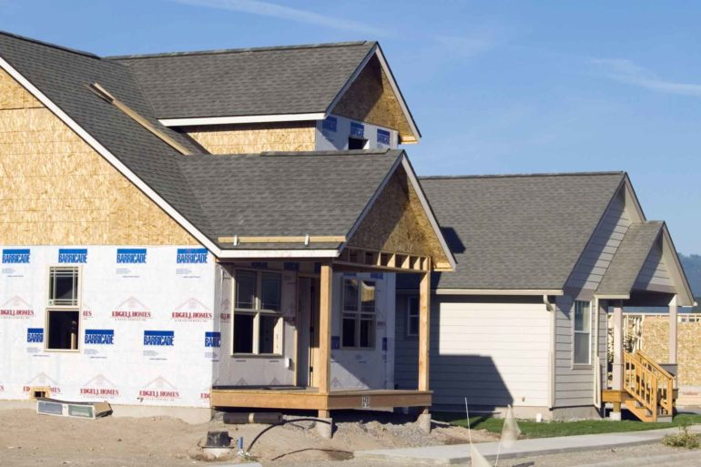 New single-family homes under construction in Missoula. (David H. Wells)
