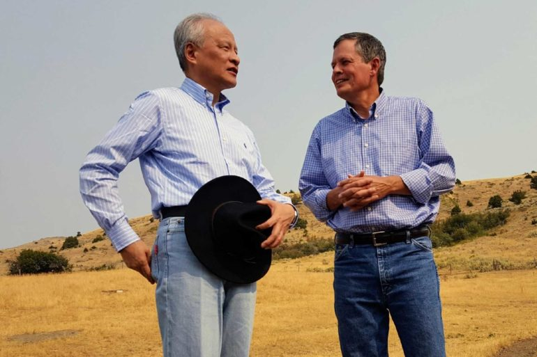 Chinese ambassador to the United States Cui Tiankai, left, speaks with U.S. Sen. Steve Daines about ways to expand the Chinese market for Montana beef. (Tom Lutey, Billings Gazette)