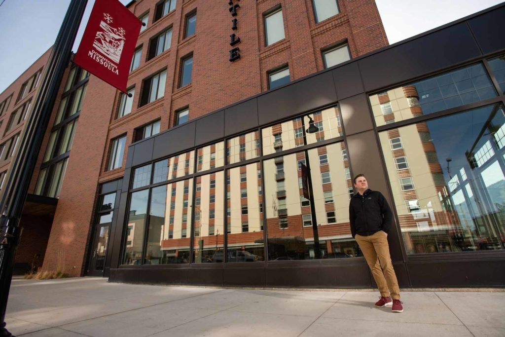Ryan Hansen, founder of Lumenad, stands outside the Marriott Hotel in Missoula, as his Florence Building offices cast a reflection in the windows. (Lido Vizzutti)